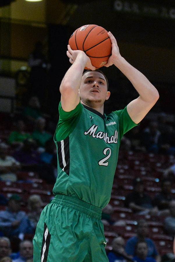 Marshall guard Stevie Browing (2) shoots a three-point shot as the Herd takes on Middle Tennessee in last season's C-USA Men's Basketball Semifinals in Birmingham, AL.