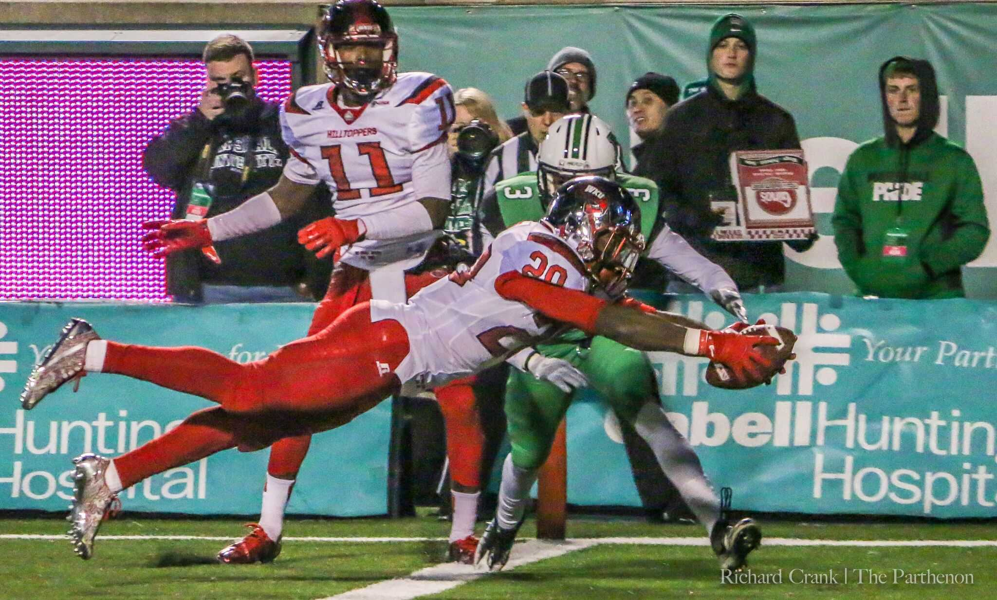 Western Kentucky running back Anthony Wales dives for the end zone in Saturday's lopsided 60-6 loss to the Hilltoppers. The loss is the worst home loss in Joan C. Edwards stadium history.