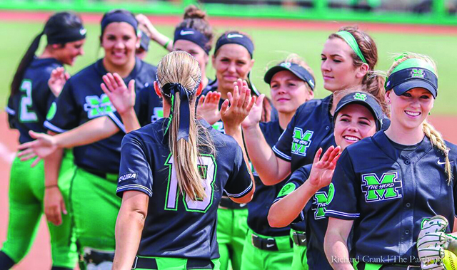 The Marshall Softball team celebrates a win after beating Wirght State April 5.