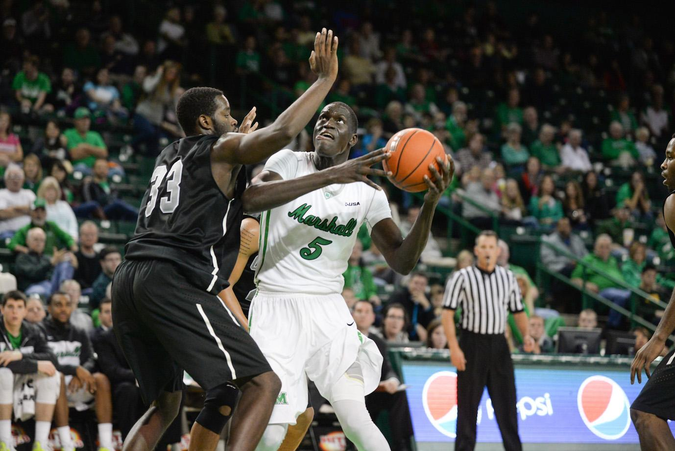 Marshall's Cheikh Sane holds as Herd men's basketball takes on Concord University in an exhibition game Nov. 8 at the Cam Henderson Center.