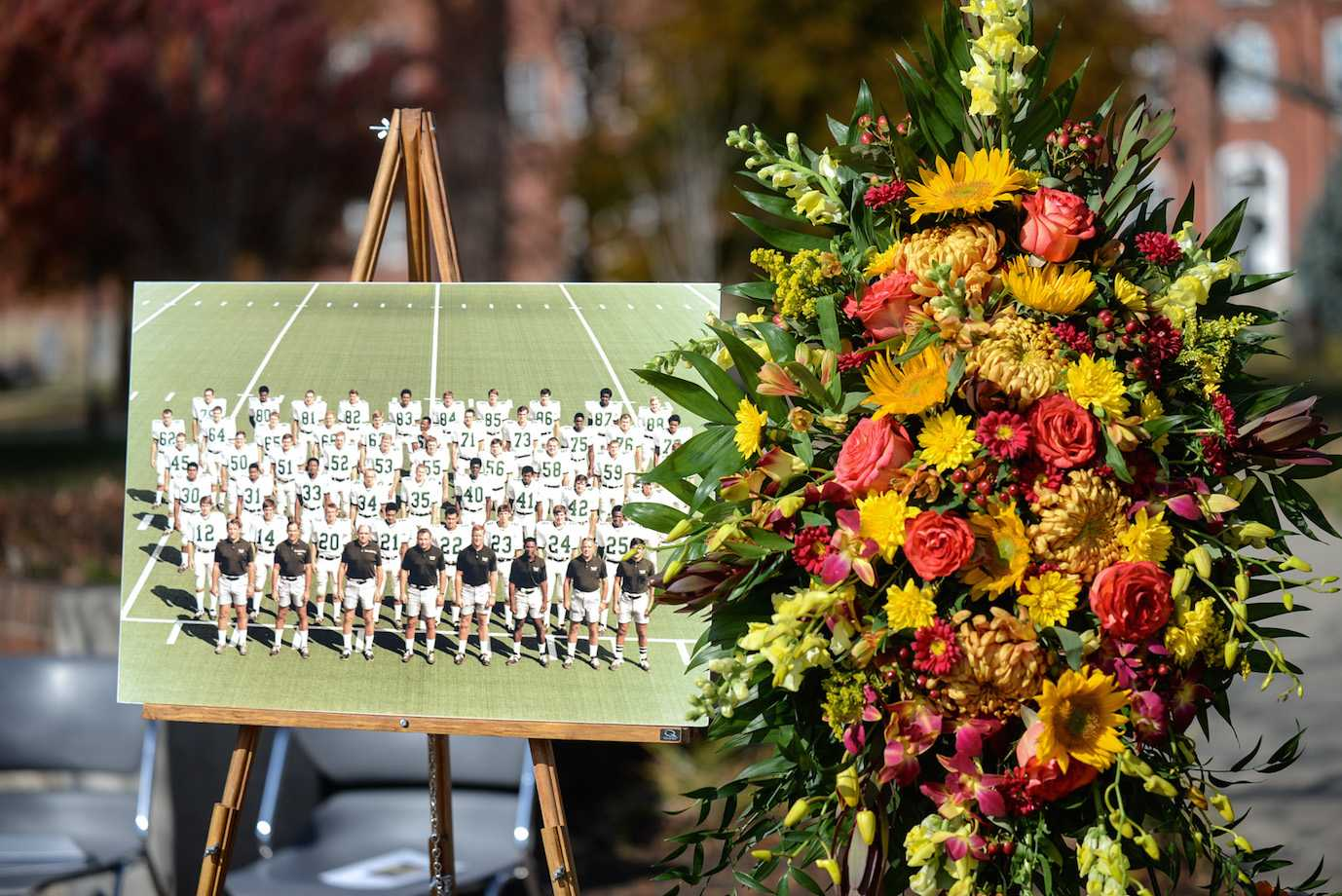 A photo of the 1970 Marshall football team is displayed during the 44th annual memorial service Friday at the Memorial Student Center plaza.