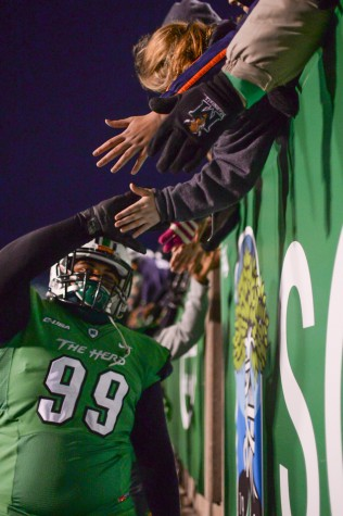 Marshall's players shake hands with fans after the Herd defeats Rice University on Saturday, Nov. 15 at the Joan C. Edwards Stadium.