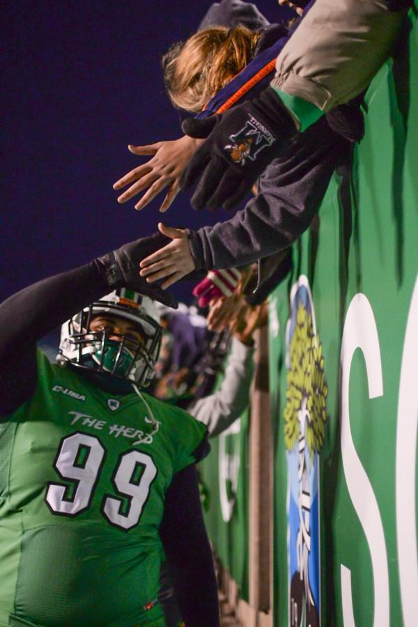 Marshall%27s+players+shake+hands+with+fans+after+the+Herd+defeats+Rice+University+on+Saturday%2C+Nov.+15+at+the+Joan+C.+Edwards+Stadium.