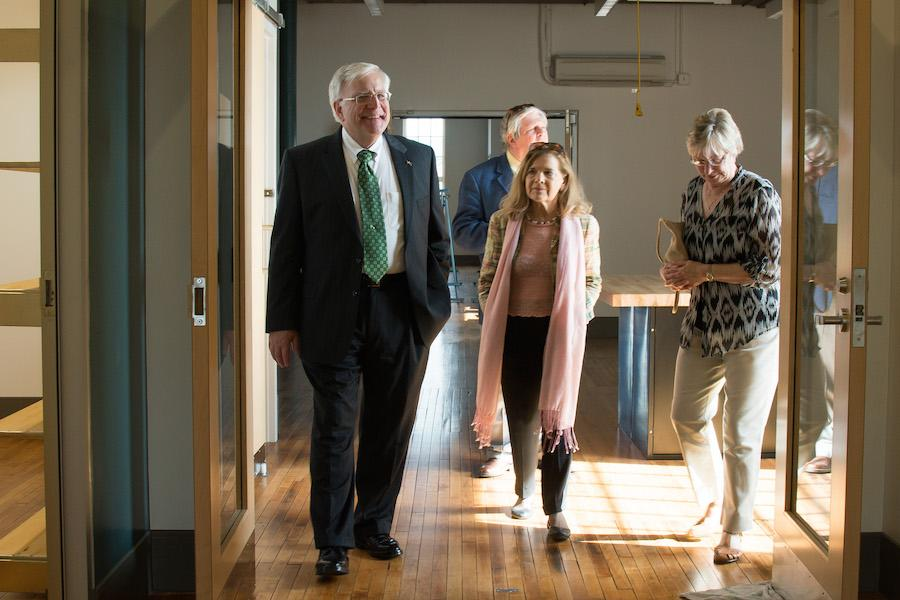 Marshall University President Stephen J. Kopp explores the university's new Visual Arts Center as it opens its doors in downtown Huntington June 25. The $13 million renovation will house eight programs from the School of Art and Design and stands adjacent to Huntington's Pullman Square.