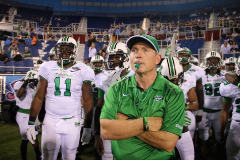 Head coach Doc Holliday doing his job at the Boca Raton Bowl Tuesday in Boca Raton, Florida.