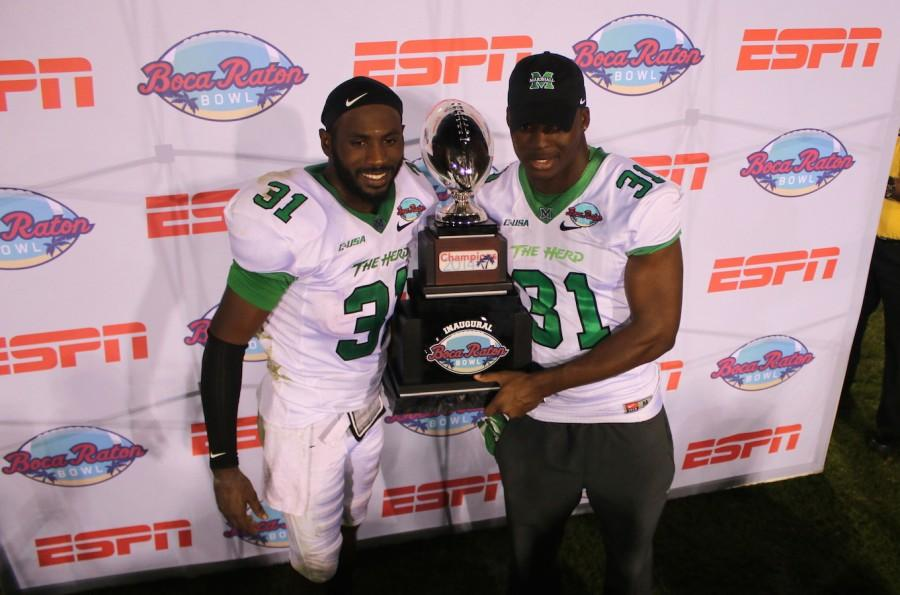 Rakeem+Cato+and+Evan+McKelvey+pose+with+the+Boca+Raton+Bowl+championship+trophy.+
