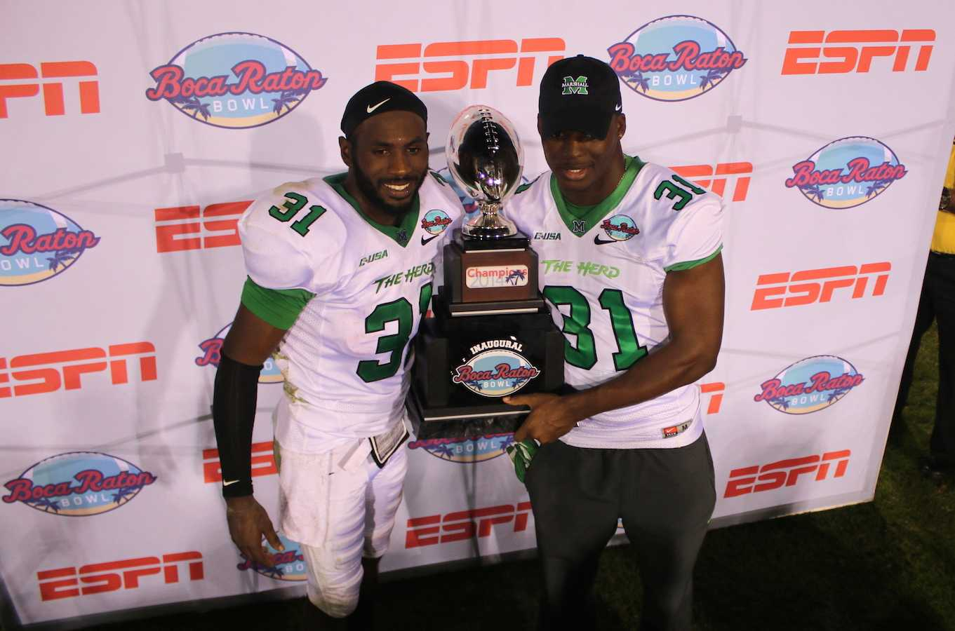 Rakeem Cato and Evan McKelvey pose with the Boca Raton Bowl championship trophy.