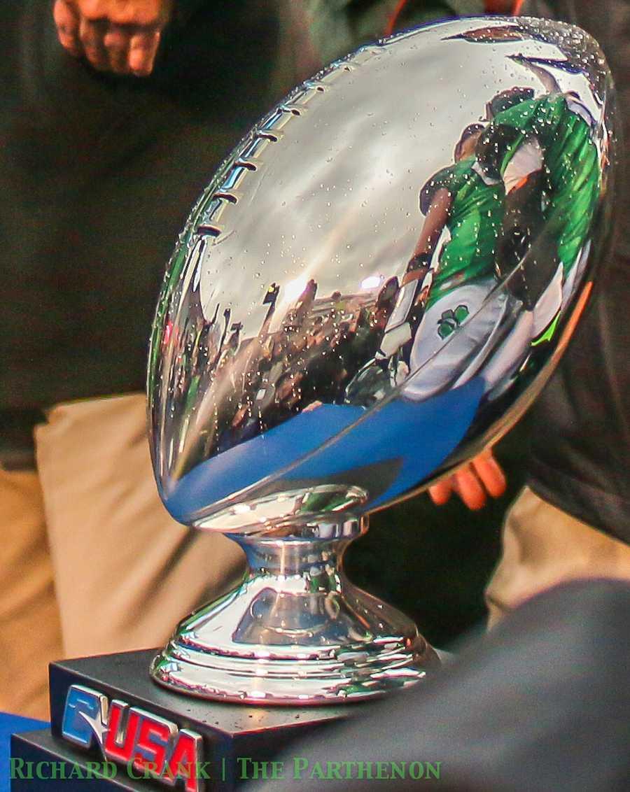 The C-USA Championship Trophy gets presented after the Marshall University football team beats Louisiana Tech University Dec. 6, 2014 at Joan C. Edwards Stadium in Huntington.