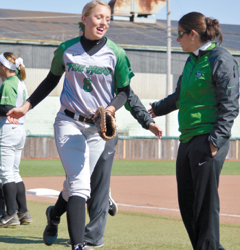 Alyssa Woodrum (left) takes the field prior to a game against Miami (Ohio) at Dot Hicks Field March 26, 2014.