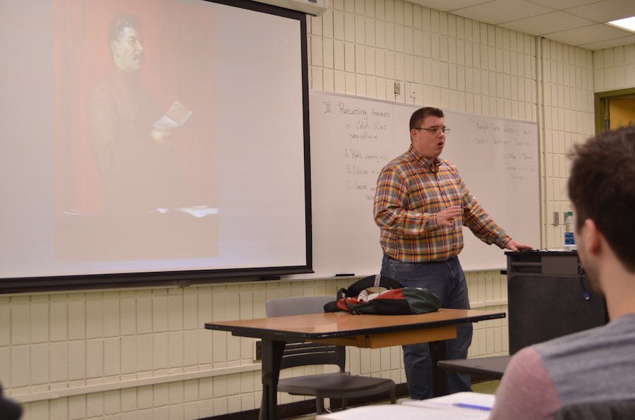 Professor Jason Morrissette giving a lecture in his War and Pop Culture class.