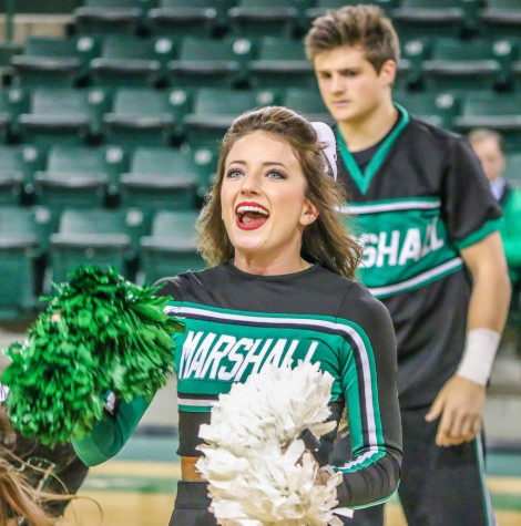 Marshall cheerleaders pump up Herd fans as the womens basketball team takes on Florida International University Thursday in the Cam Henderson Center.