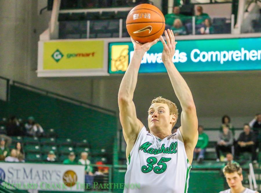 Austin Loop, Marshall men's basketball sophomore guard, shoots the ball against UTEP Jen. 24 at the Cam Henderson Center.