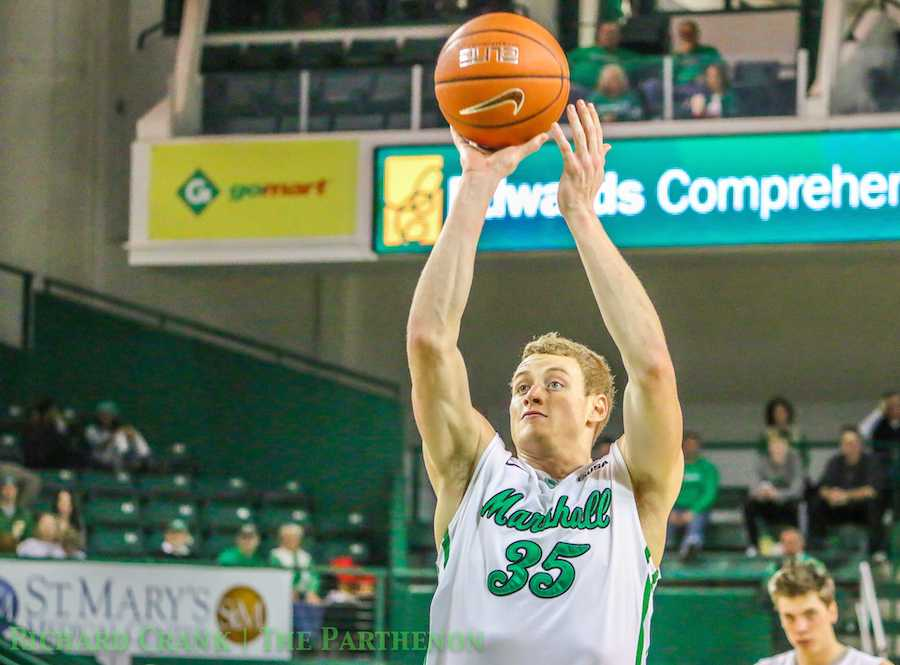 Austin Loop, Marshall men's basketball sophomore guard, shoots the ball against UTEP Jen. 24 at the Cam Henderson Center.