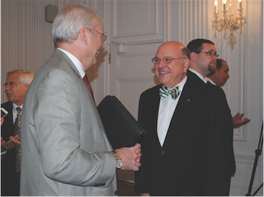 Interim President Gary White (right) and Vice Chancellor for Academic Affairs, Corley Dennison (left), talk during West Virginia Higher Education Day Tuesday in Charleston.