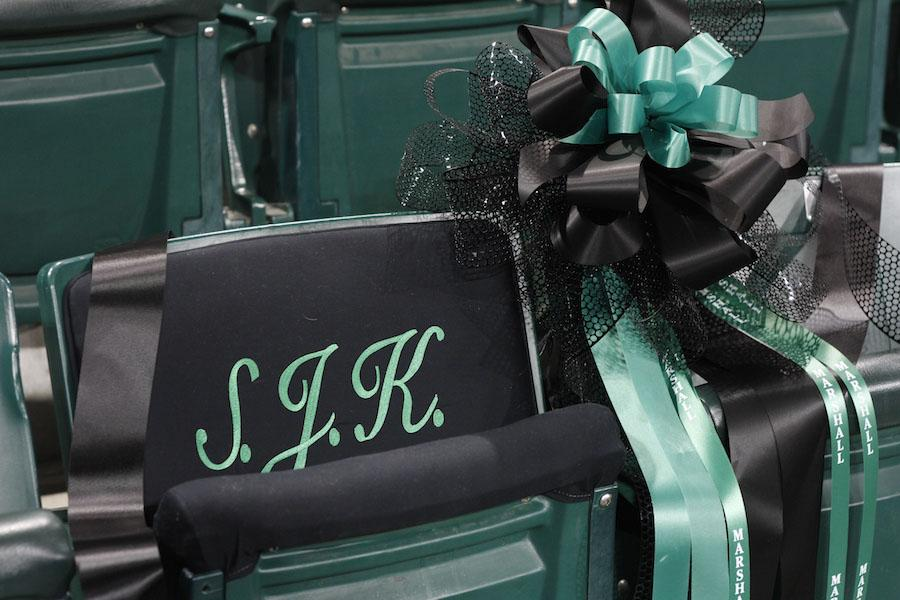 Former Marshall President Stephen J. Kopp's seat in the Cam Henderson Center is decorated with embroidery and a commemorative ribbon at the memorial service January 13.