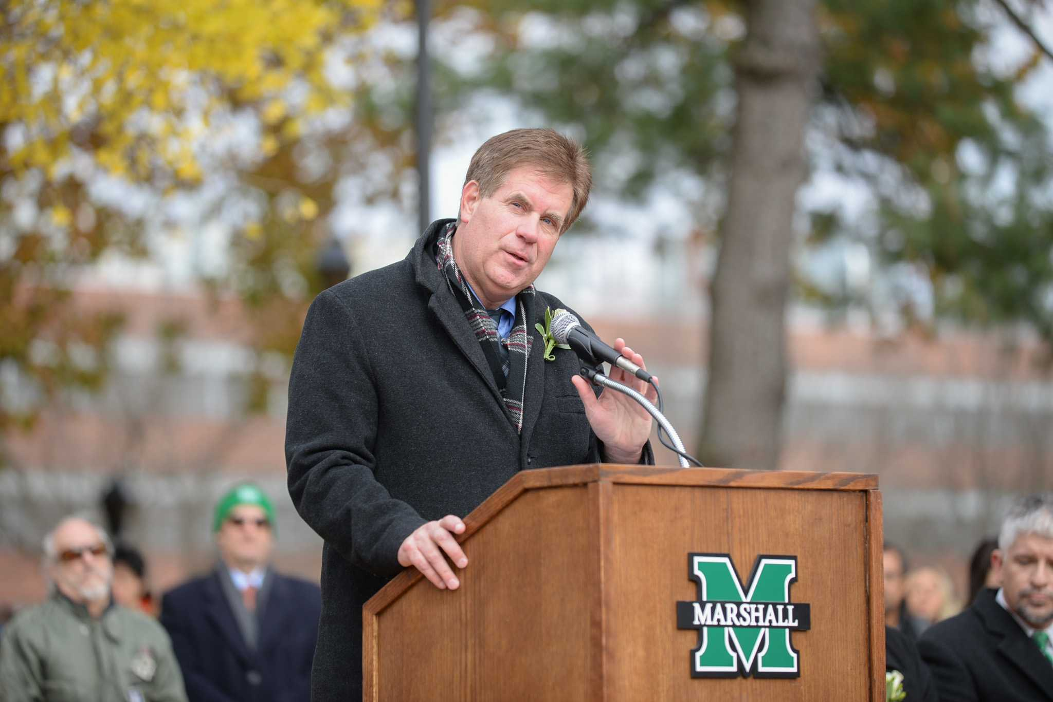 Mike Hamrick, athletic director, delivers a speech during the 44th annual memorial service on Friday at the Memorial Student Center Plaza.