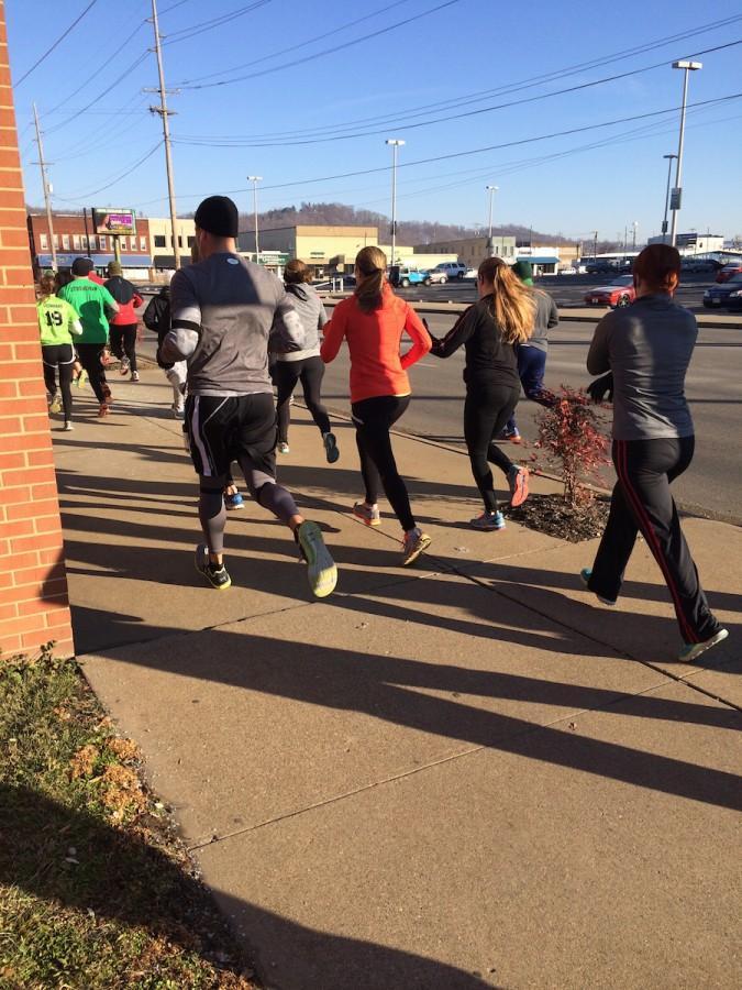 Runners competing in the annual Pump and Run head down 20th Street toward Third Avenue Saturday.