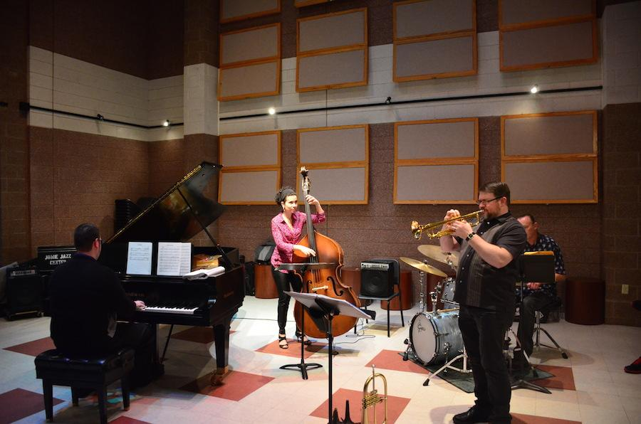 Natalie Boeyink plays the bass with Zach Arbogast on piano and Steve Hall on drums Wednesday at the Jomie Jazz Center.