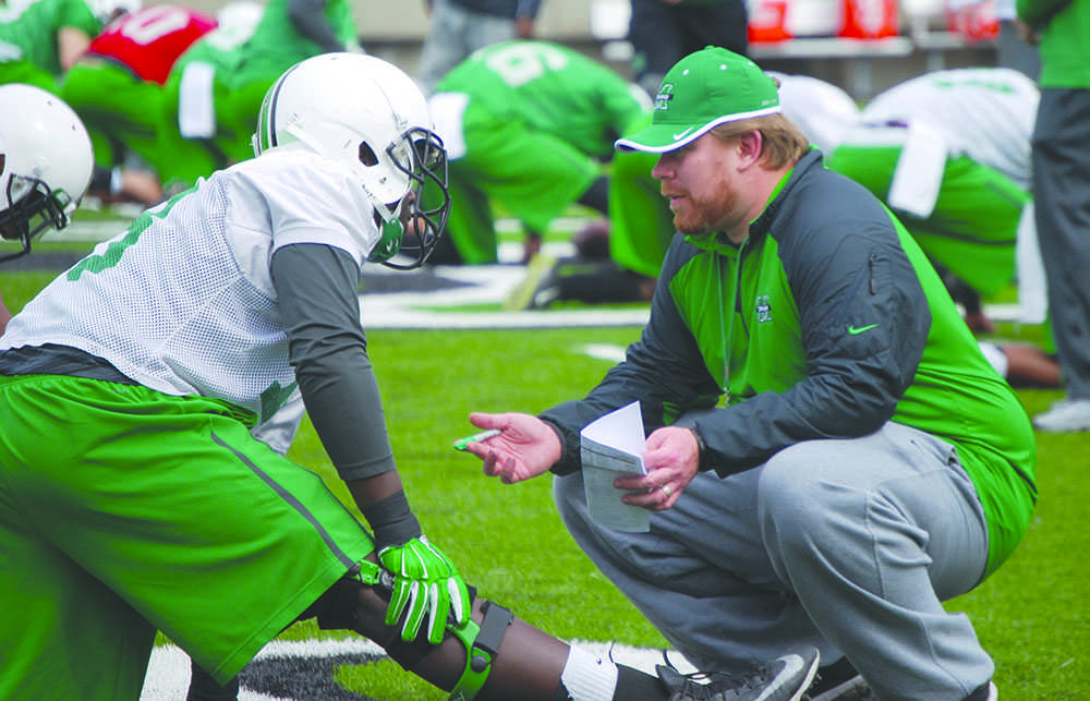 The 2015 Marshall University football team starts drills during its first spring practice Tuesday at the Joan C. Edwards Stadium.
