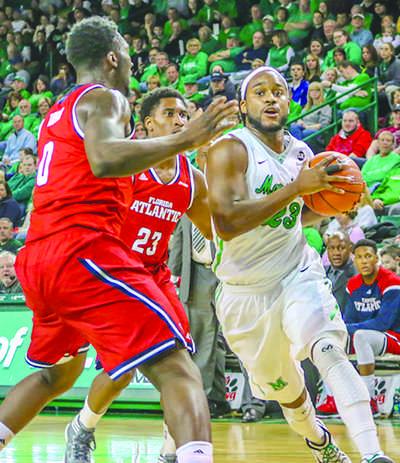 Justin Edmonds defends the ball against Florida Atlantic University Saturday.