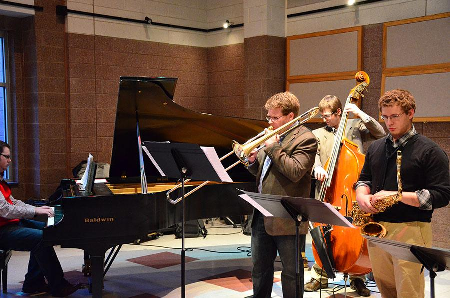 Trombonist Jason Miller, left, performs Wednesday at the Jomie Jazz Center to close out the Guest Artist Series.