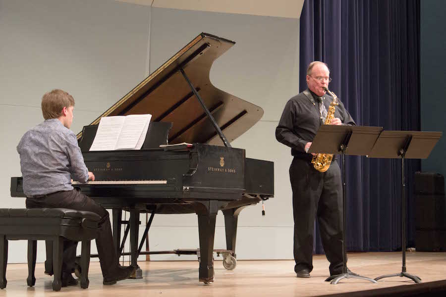 Edwin Bingham, professor of saxophone and jazz studies at Marshall University, right, and Henning Vauth, coordinator of keyboard studies perform at a sax recital Monday.
