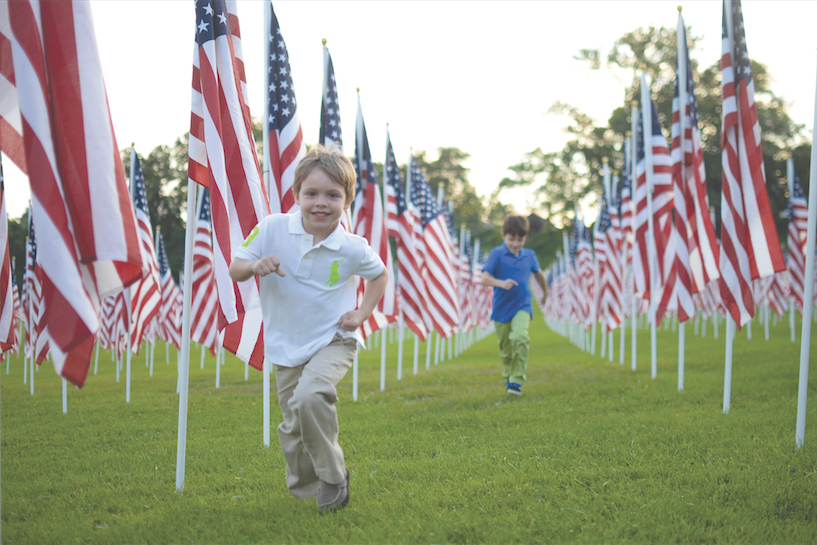 Children+visit+the+Healing+Field%2C+a+memorial+for+those+who+died+Sept.+11%2C+2001%2C+the+1970+Marshall+plane+crash+victims+and+veterans+of+the+armed+forces+Sept.+10%2C+2014+in+Spring+Hill+Cemetery.