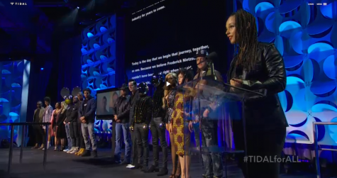 Alicia Keys shares the stage with the rest of the Tidal stakeholders.