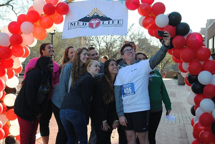 Marshall Medlife Members pose for a selfie at the finish line of the Medlife 5k on Marshall's campus Saturday.