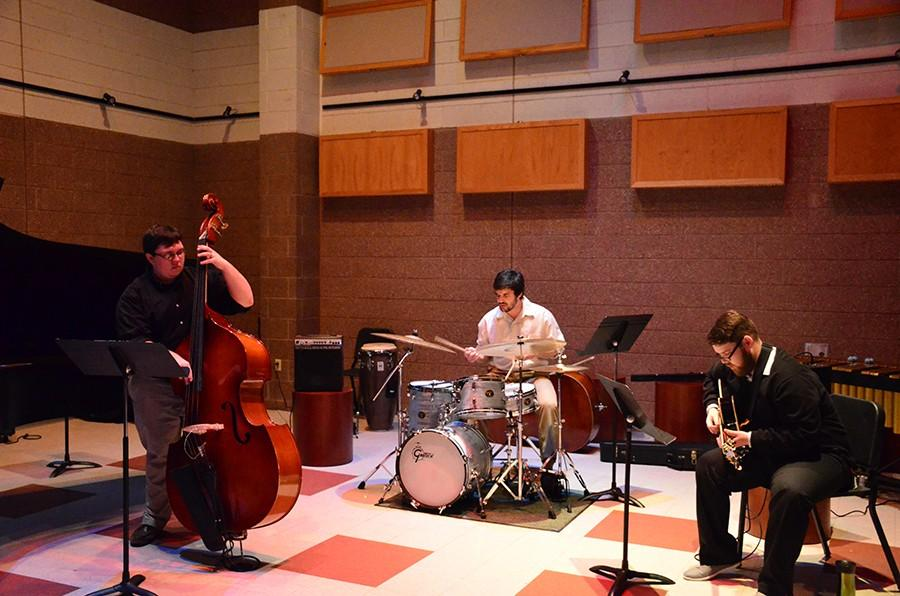 Colin+Milam%2C+left%2C+performs+bass+at+his+junior+recital+Tuesday%2C+accompanied+by+Tyler+Stewart+on+drums+and+Stephen+Dorsey+on+Guitar.