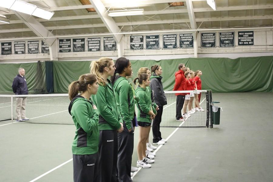 The+Marshall+University+tennis+team+pauses+for+the+national+prior+to+its+match+with+Radford+University+Jan.+26%2C+2014.+