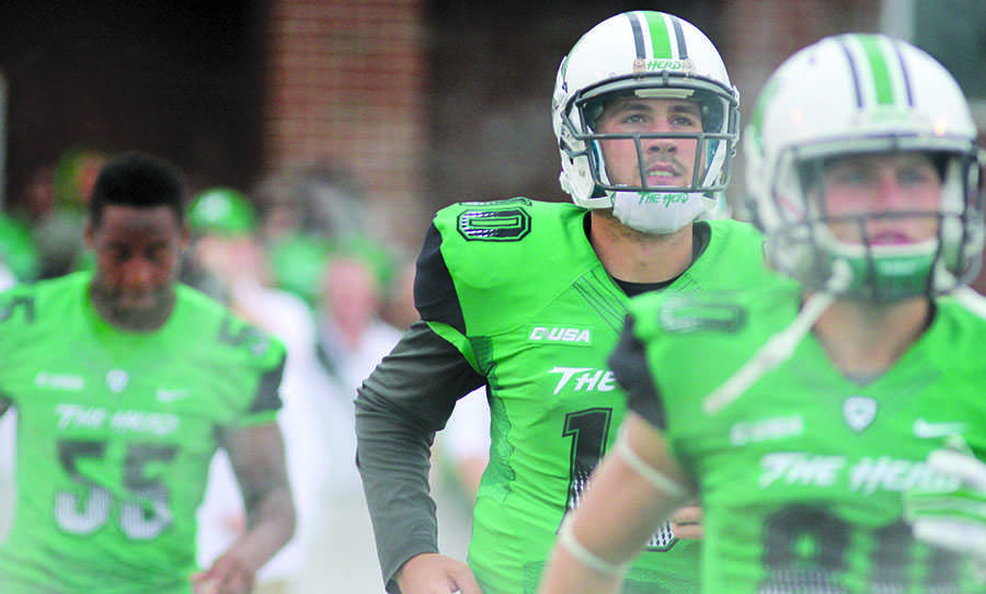 Gunnar Holcomb takes the field with the Herd as it faces Ohio University Sept. 13, 2014 at Joan C. Edwards Stadium.