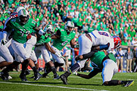 Lexi Browning/The Parthenon Marshall's Taj Letman takes down Greg Howell as the Thundering Herd takes on Florida Atlantic University on Saturday, Oct. 25 at the Joan C. Edwards Stadium in Huntington.