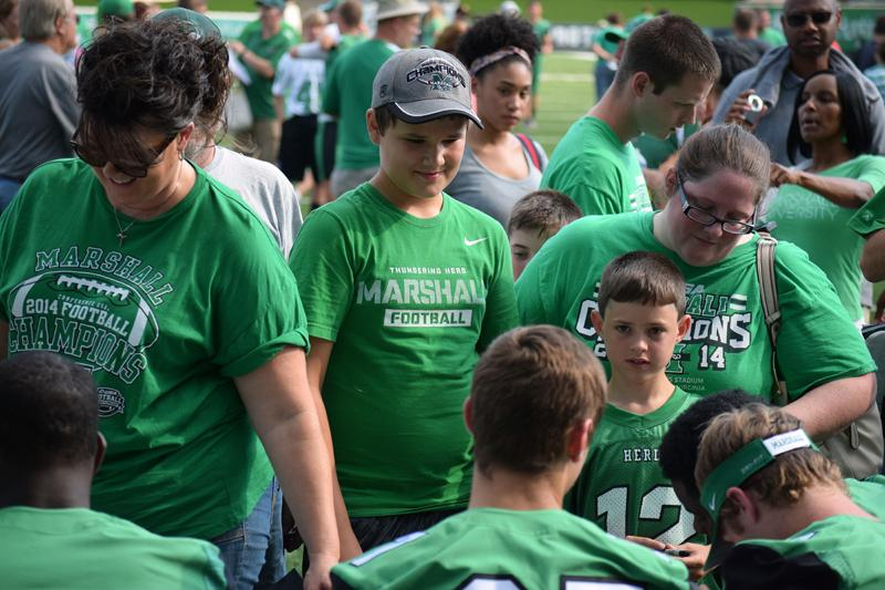Marshall+University+football+held+its+annual+fan+fest+Sunday+evening.+After+Thundering+Herd+players+took+team+photos%2C+they+signed+autographs+and+took+pictures+with+hundreds+of+fans.+The+Herd+opens+the+2015+season+with+a+home+game+against+Purdue+University+on+Sept.6.
