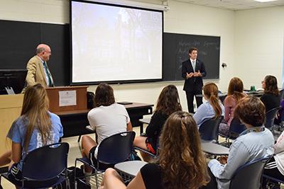 Interim President Gary White and Student Body President Duncan Waugaman teaching UNI 100 to freshman.