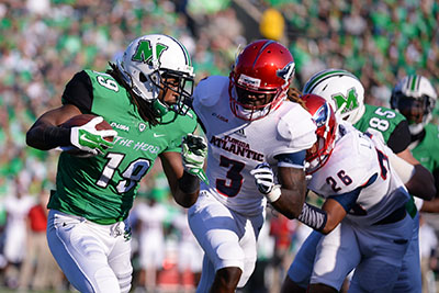Lexi Browning/The Parthenon Marshall's Deandre Reaves (19) runs as the Thundering Herd takes on Florida Atlantic University on Saturday, Oct. 25 at the Joan C. Edwards Stadium in Huntington.