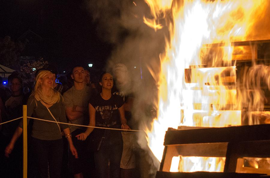 Students participate in the Homecoming bonfire Thursday night next to Harless Dining Hall.