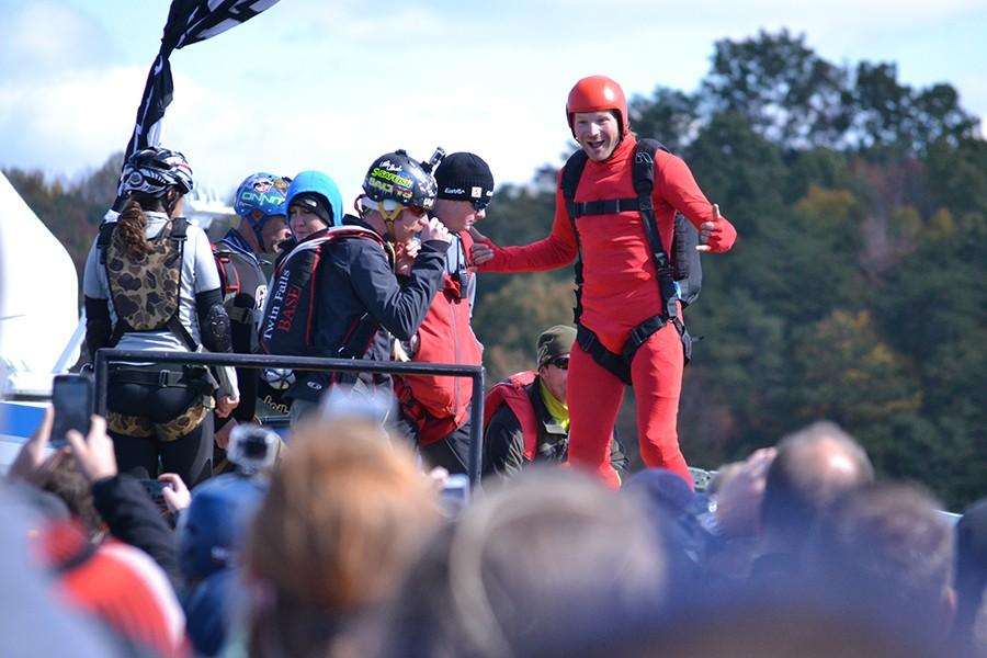 A+base+jumper+pumps+himself+up+for+the+876-foot+plunge+at+Bridge+Day+Saturday.+
