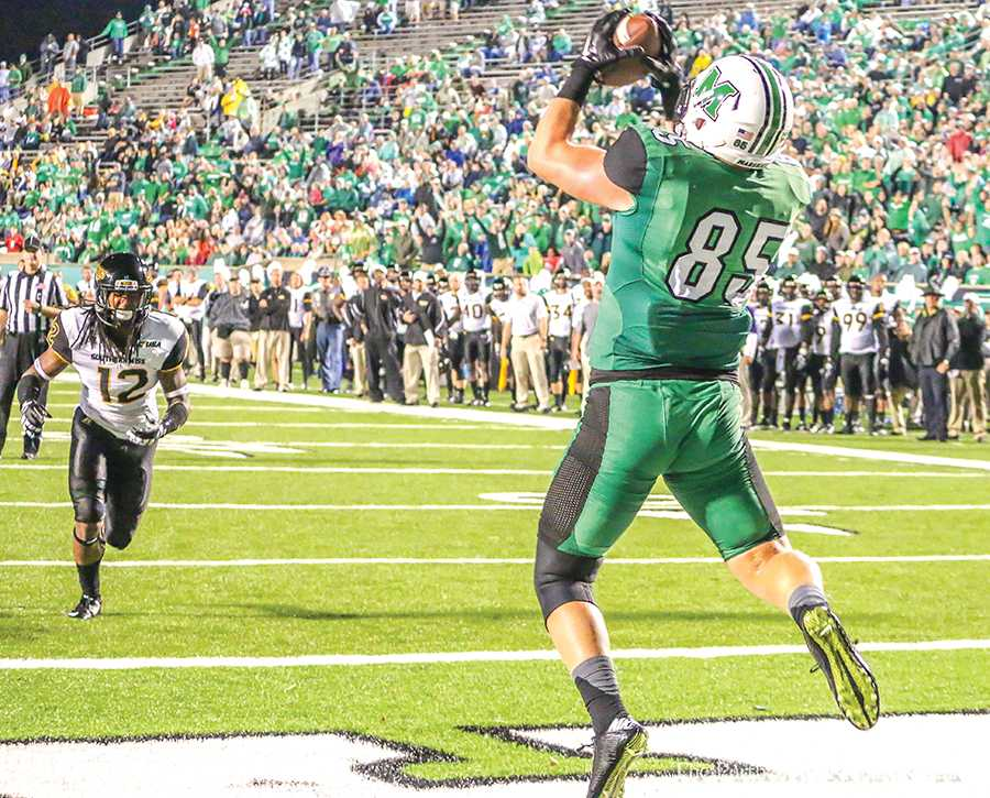 Marshall University sophomore tight end Ryan Yurachek catches a touchdown pass during its game against the University of Southern Mississippi Oct. 9.