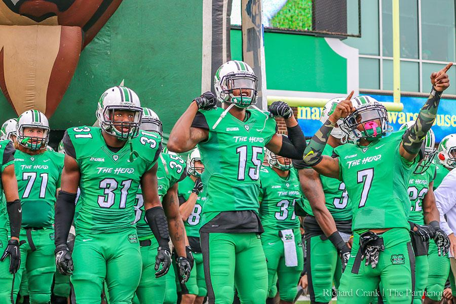 The Marshall University football team prepares to take the field for its Homecoming Game against the University of North Texas during the 2015 season.