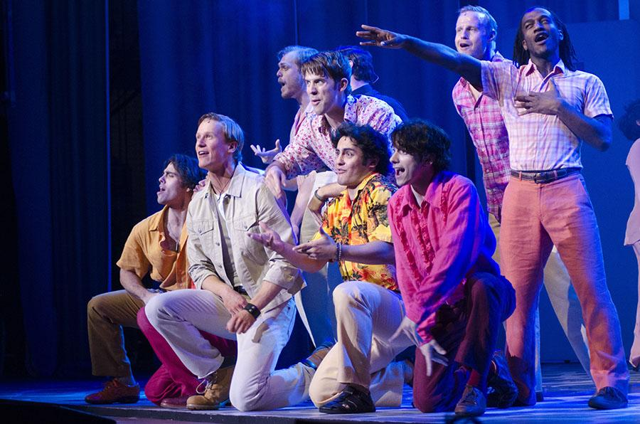 """The cast kneels down to sing in one of the finals musical numbers of """"Mamma Mia"""" Wednesday."""