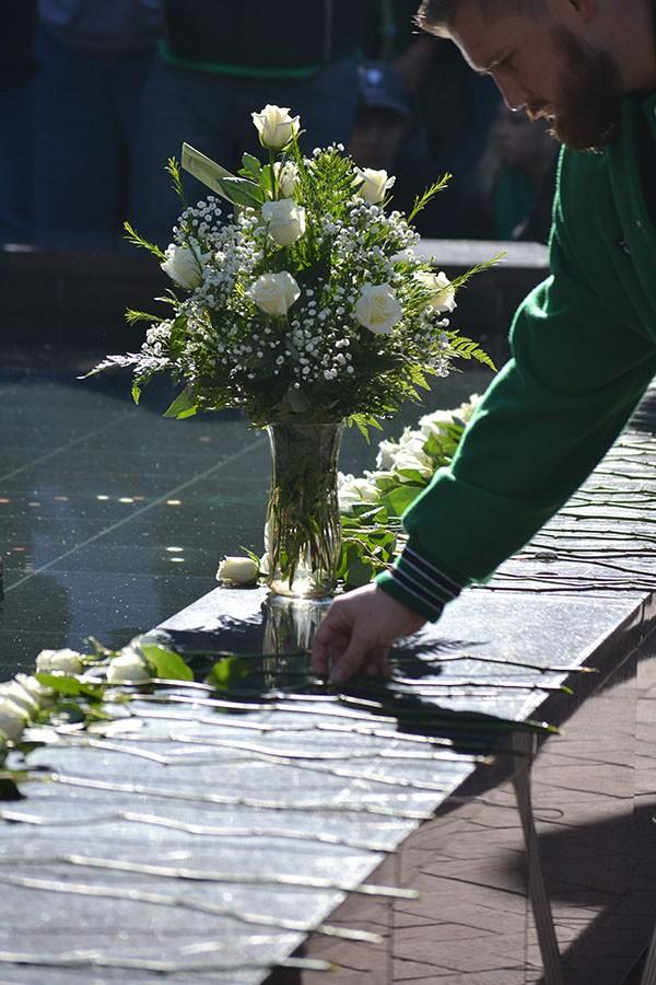+Each+rose+laid+on+the+fountain+represents+one+of+the+75+people+who+died+in+the+crash.%0A
