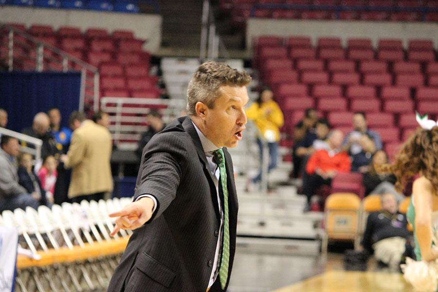 Marshall women's basketball head coach Matt Daniel directs his players from the sidelines in the Charleston Capital Classic last season.