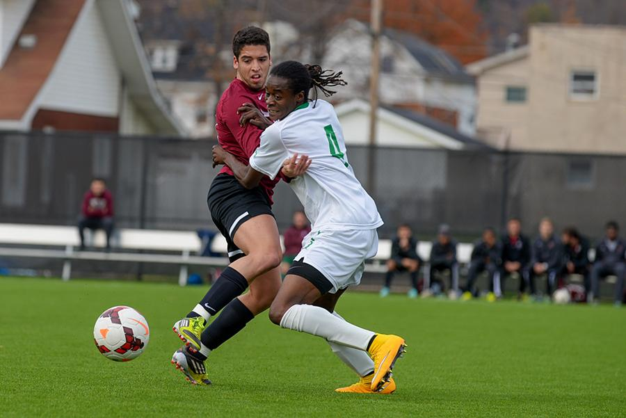Senior defender Matt Freeman attempts to gain possession in a match last season.