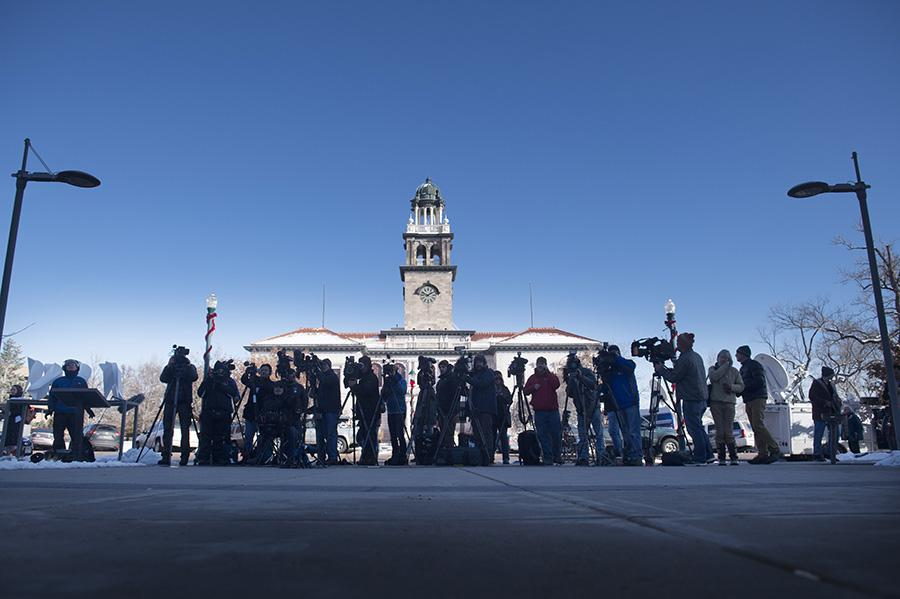 Members of the media gather outside the El Paso County Terry R. Harris Judicial Complex in Colorado Springs, Colo. Monday, Nov. 30, 2015, during the first court appearance for Colorado Springs Planned Parenthood shooting suspect Robert Dear. In the background of this photo is the Colorado Springs Pioneers Museum. (Mark Reis/The Gazette via AP)