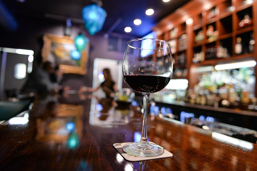 A glass of wine is displayed at the Cellar Door restaurant in Huntington on Thursday, Jan. 20.