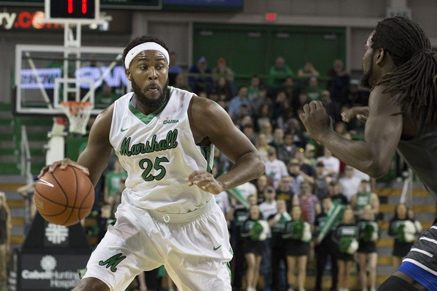 Marshall University junior Ryan Taylor makes a move to the basket against Middle Tennessee State University Thursday at the Cam Henderson Center.