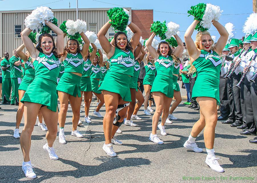 Marshall University cheerleaders perform for the crowd before a game outside of Joan C. Edwards Stadium during the 2015 football season.