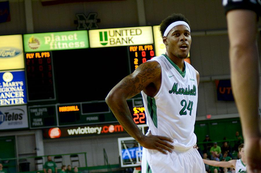 Marshall University senior forward James Kelly waits for the ball at the free-throw line during a game earlier this season at the Cam Henderson Center.