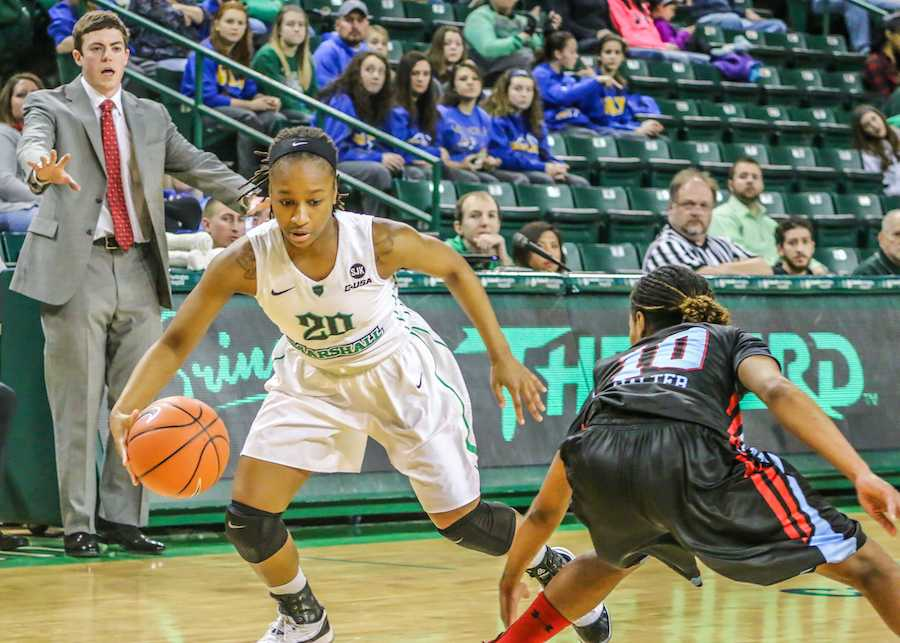 Senior guard Norrisha Victrum goes around a defender during a game last season at the Cam Henderson Center.